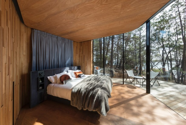 Possum pelts soften Tasmanian-made plywood flooring, the handrail is wrapped in leather and the king bed with gold ...
