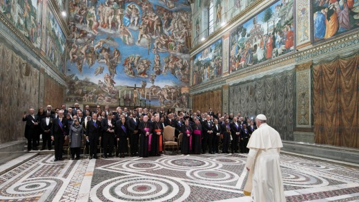 Pope Francis arrives to pose for a family photo with diplomats inside the Sistine Chapel. Tourists aren't allowed to ...
