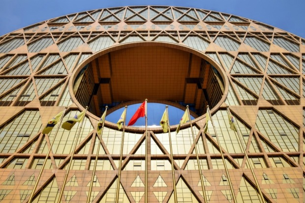 GUANGZHOU CIRCLE: Housing a plastics company and trading centre, this wheel-like building looks as if it's about to roll ...
