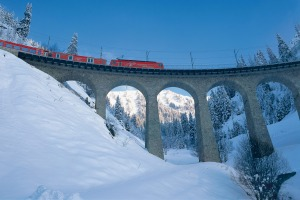 Admire the scenery over a drink on the red Apres-Ski Train of the Matterhorn Gotthard Bahn.