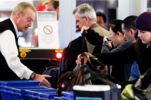 Passengers have their bags checked at Melbourne Airport.
