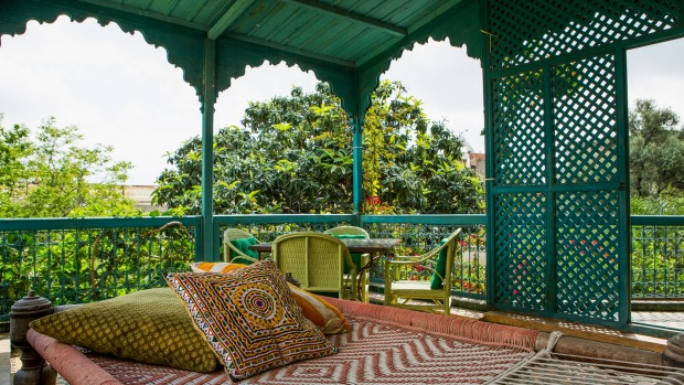 The Sultanas suite opens to a wide, covered balcony.
