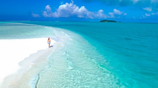 The water is so clear and the sand so white that the lagoon sometimes feels unreal.