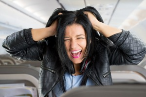 Sometimes it's impossible to avoid annoying plane passengers – even when it's your own child.