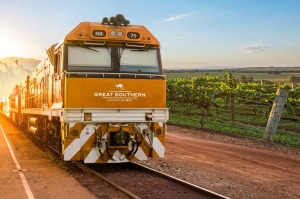 "The livery of the diesel engine which will pull the first Great Southern train is a ""sunset-inspired burnt orange""."