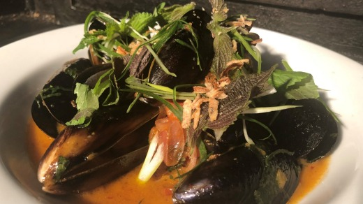 Fumo's sake steamed mussels with kimchi butter and shiso leaf.