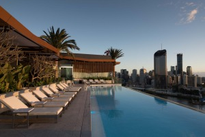 The hotel's 23-metre heated rooftop pool overlooks the river.