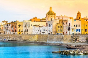 Trapani is a raffish port, grand but seagull-screeched on a sickle-shaped peninsula.
