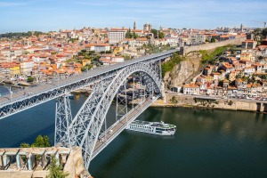 Emerald Radiance cruises a river in Porto.