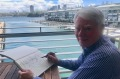 Architect and artist Chris Johnson sketching outside his apartment at Walsh Bay, Sydney.