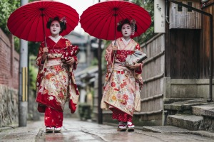 Maiko geisha walking on a street of Gion in Kyoto.