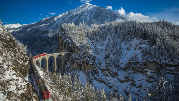 Passengers can enjoy the sights of Switzerland's Alpine terrain by train.