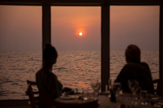 Watching the sunset from the Coral Discoverer's dining room.