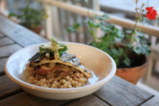 Blooming Hill Organic Farm serves farm-fresh meals such as this grilled fish with pearl barley and fall vegetables: ...