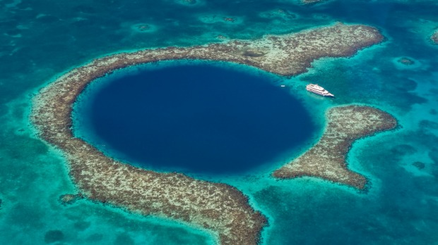 The Great Blue Hole off the coast of Belize. it's large enough to fit two Boeing 747 jumbo jets inside.