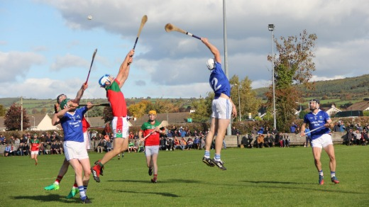 Players from hurling clubs James Stephens and Erin's Own do battle in a quarter-final clash in Ballyragget, County ...
