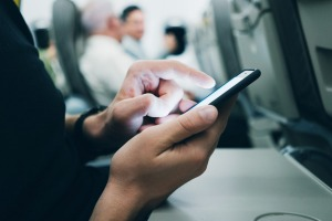 A female passenger was sent pornographic images via iPhone's AirDrop function while on a flight.