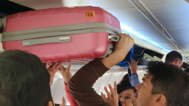 Oversized bags are creating havoc on domestic flights.