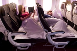 The Skycouch converts three economy class seats into a 'bed'.