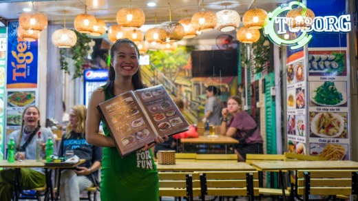 Waitress at Bia Hoi corner, Hanoi, where venues are high on quality and low on pretence.