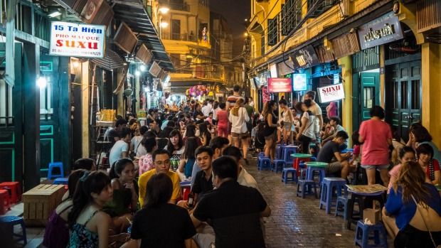 Tourists enjoying night life at Bia Hoi Beer Bars in the old quarter of Hanoi.