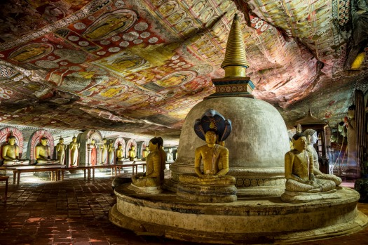 DAMBULLA CAVE TEMPLE: From the roadside the kitsch Golden Temple, with its neon sign and 30-metre high golden Buddha on ...