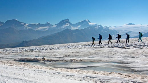 Trekkers descending on a glacier from Rifugio Teodulo, part of the Tour de Monte Rosa.
