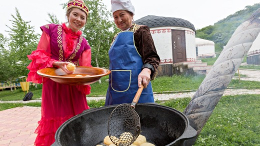 Kazakh women make traditional local bread known as Baursak in Almaty.