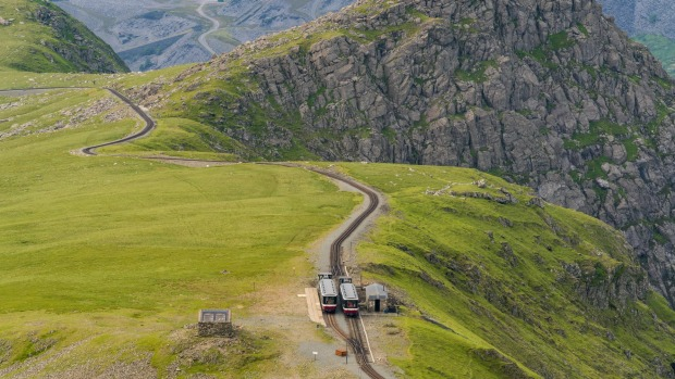 SNOWDON MOUNTAIN RAILWAY, WALES: Dominating northwest Wales, Snowdonia National Park features rugged peaks and moors. An ...