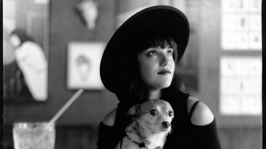 Kyle de Vre's portrait of musician Fiona Silver and tiny pal, Winston, at Sophie's bar, New York.