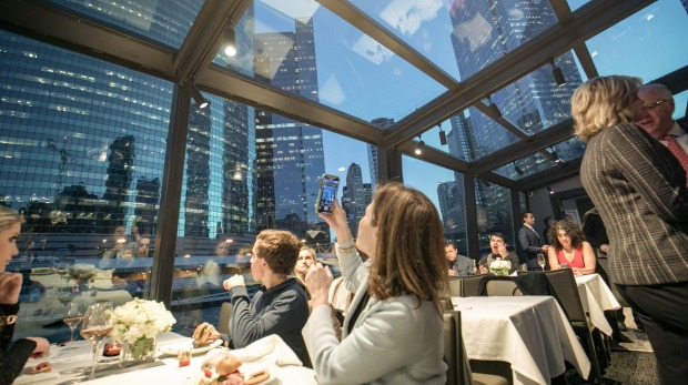 Dinner with city views on the Odyssey Chicago River cruise.