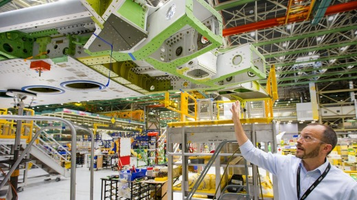Jason Clark, vice president of 777/777X Operations, points out the crucial hinge on the Boeing 777X that enables the ...