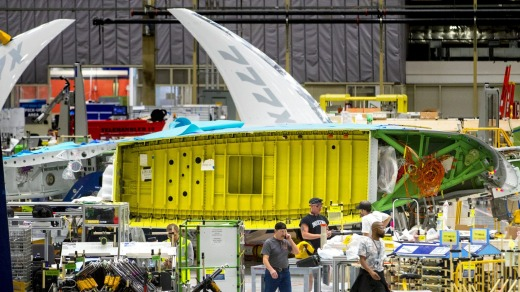 A view of the new Boeing 777X wing from the interface with the fuselage in the foreground and the folded wingtip at the ...
