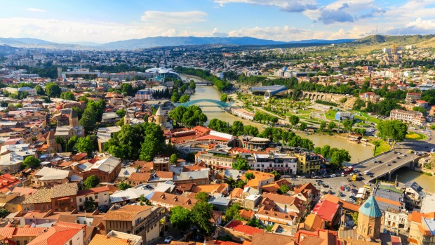 Squished between Europe and Asia, the Georgian capital of Tbilisi is a city in bloom, set in a dramatic valley through ...