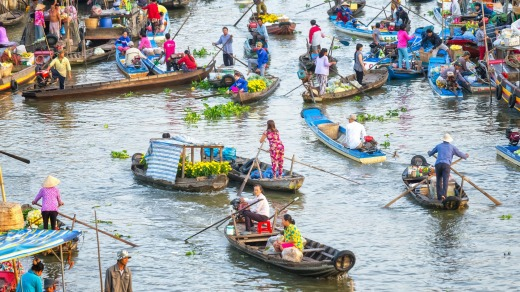 Bustling crowded living on floating market in Soc Trang, Vietnam.