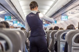 Flight attendants serve you food and drinks on a flight, but should you tip them in the US?