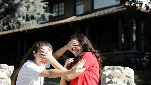 Abby Olague, 15, left, and her sister Bella Olague, 14, of Chino improvise their Bird Box at the house in Monrovia, ...