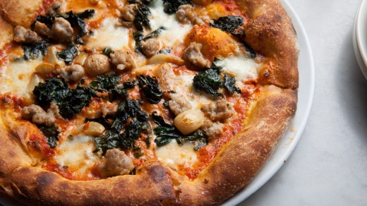 Milo & Olive's pork belly, sausage and kale pizza.