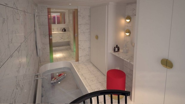 """Features include a marble-clad bathroom with a """"peek-a-boo"""" window overlooking the bedroom and ocean."""