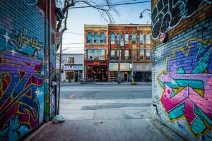 Street art in Graffiti Alley and buildings on Queen Street West, in the Fashion District of Toronto.