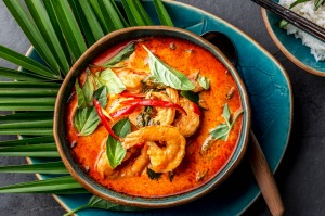Red curry soup with shrimps prawns and coconut milk.