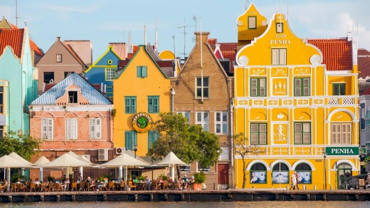 Dutch architecture and cafes line the waterfont on the Punda side of Willemstad in Curacao.