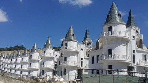 More than 700 Gothic-style villas, each resembling an identikit miniature castle, are laid out immediately to the ...