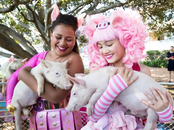 SYDNEY LUNAR FESTIVAL AUSTRALIA: Lilyana Wawavanua, left, and Maya Miller, right, with a pig at the launch of the Sydney ...