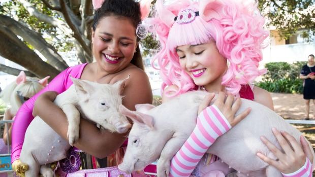 Lilyana Wawavanua, left, and Maya Miller, right, with a pig at the launch of the Sydney Lunar Festival for the Chinese ...