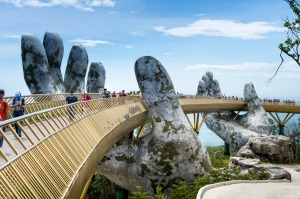 The Golden Bridge on Ba Na Hill in Danang, Vietnam. If you love to travel and you don't have a lot of money to spend, ...