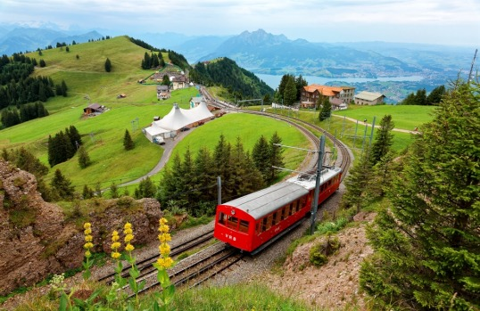 MT RIGI RAILWAY, SWITZERLAND: Europe's oldest mountain railway opened in 1871 and was soon famous thanks to early ...