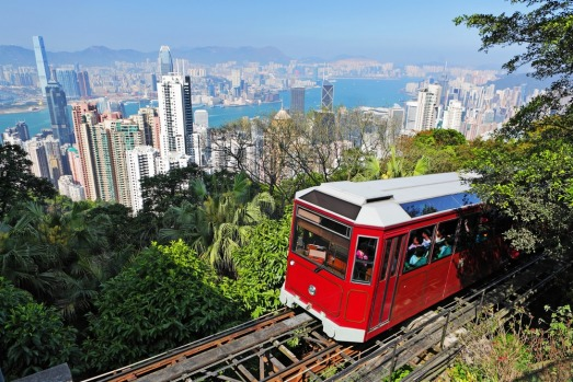 PEAK TRAM, HONG KONG: The iconic red carriages of this rack railway, inaugurated in 1888, climb behind skyscrapers to ...