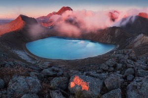 Early morning sunrise, landscape scenery of blue lake, wild mountains and huge volcano, autumn colours and golden sun ...