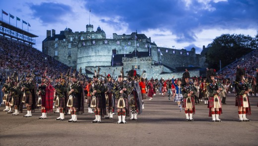 The Royal Edinburgh Military Tattoo performs with the city's famous castle as backdrop.